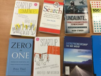 Library of tech entrepreneur books and devices