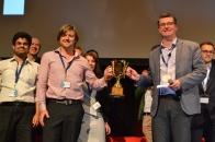 Pete Cooper awarding The Startup Trophy at SydStart 2014 to GoFar Cofounder Danny Adams